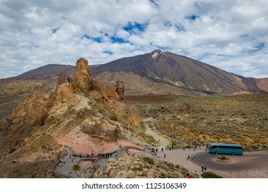 Tourisic bus and group of tourists visiting Mirador de la Ruleta, and national park Teide at Tenerife island. Canarias. Spain.
