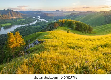 Tourism in Altay, Russia. View of the valley and the Katun River from the mountain. Spring panoramic view. Evening light.