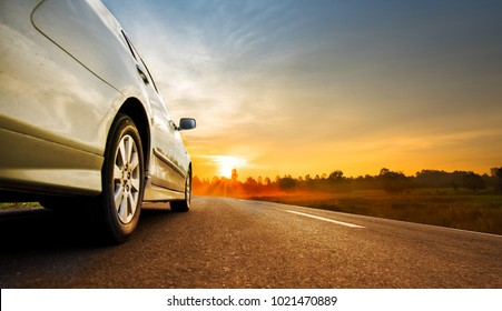 Tourism car on highway with sunset landscape