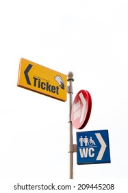 Tourism concept - guideposts used in tourist places: ticket, book shop, wc.