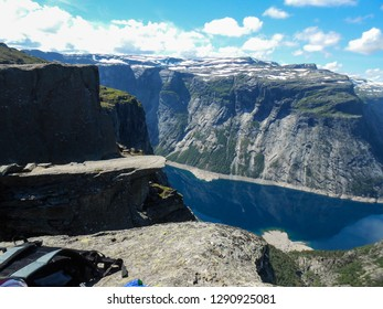 Tourism concept View of Trolltunga cliff. The Troll's tongue Odda, Norway