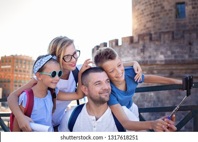 Tourism. Famliy of 4 persons taking selfie and having fun together. Summer vacation.