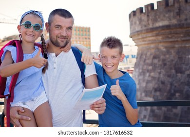 Tourism. Father with children having fun together. Summer vacation.