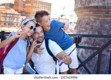 Tourism. Father with children taking selfie and having fun together. Summer vacation.