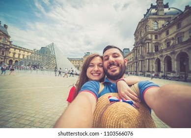 Tourism in Paris, France. handsome tourist taking selfie photo traveling in Europe capitals. Concept of fun, joy, discovering and love
