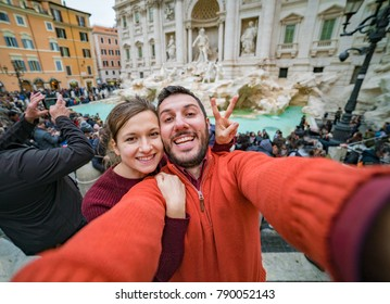 tourism in Rome, handsome couple smiling in the Trevi Fountain in Rome, Italy