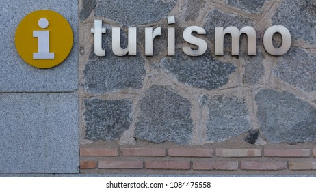 Tourism sign written in Spanish with the information symbol. The word Turismo has the same spelling and meaning also for the Portuguese language.