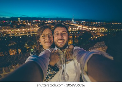tourism in Turin (Torino), Italy. Happy beautiful couple take slefie photo in Torino, Piedmont.
