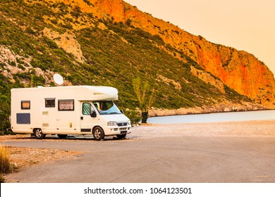 Tourism vacation and travel. Camper van on beach sea shore in summer time, Greece