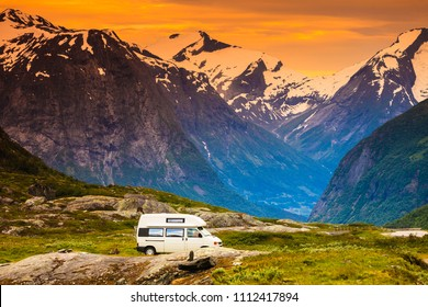 Tourism vacation and travel. Camper van car in norwegian mountains