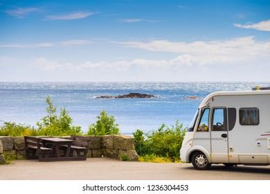 Tourism vacation and travel. Camper van and rocky coast landscape of southern Norway with an ocean view in Rogaland county Norway.