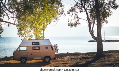 Tourism vacation and travel. Camper van on beach seashore in Greece