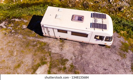 Tourism vacation and travel. Camper van with solar panels on roof in summer mountains landscape. National tourist route Aurlandsfjellet.