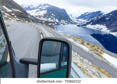 Tourism vacation and travel. Camper van on road in mountains landscape in Norway