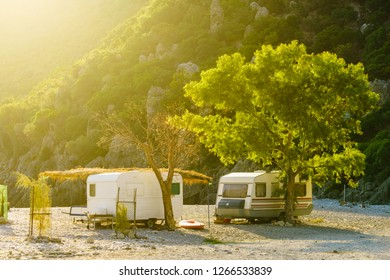 Tourism vacation and travel. Caravan trailer on sunny beach in Greece