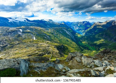Tourism vacation and travel. Fantastic view on Geirangerfjord and mountains landscape from Dalsnibba viewpoint, Geiranger Skywalk platform, Norway.