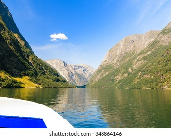 Tourism vacation and travel. Mountains and fjord Sognefjord in Norway, Scandinavia. View from boat