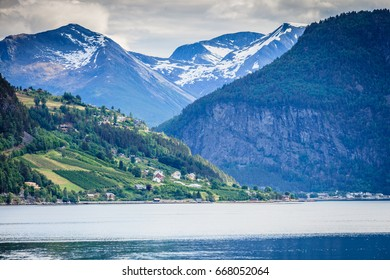 Tourism vacation and travel. Mountains landscape and fjord in Norway Scandinavia Europe. Norddalsfjorden as seen from ferry. Beautiful nature