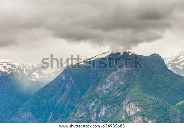 Tourism vacation and travel. Mountains landscape, stormy cloudy sky, Norway, Scandinavia.