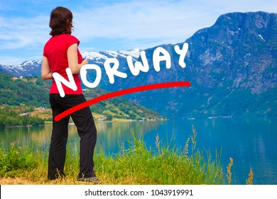 Tourism vacation and travel. Woman tourist enjoying mountains fjords view in Jostedalsbreen National Park, Oppstryn (Stryn), Sogn og Fjordane county. Norway Scandinavia.