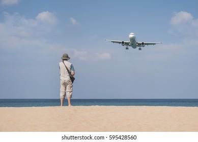 Tourist with airplane prepare landing in the airport at Mai Khao Beach, Phuket Thailand