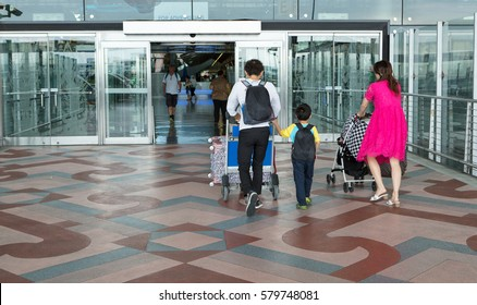 tourist at the airport terminal building gate entrance and automatic glass door