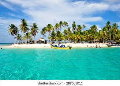 Tourist arraving beautiful beach with crystal clear turquoise water.