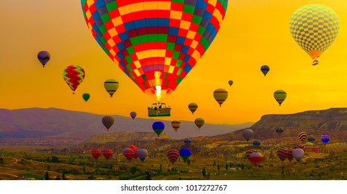 tourist attraction of Cappadocia - Hot air balloons landing in a mountain sunrise