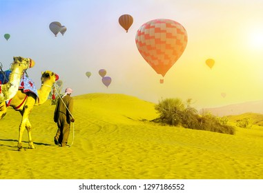 Tourist attractions Hot Air balloons flying adventure sunset sand desert safari camels in the Dubai, Tourists are taken on camel rides Bedouin.