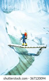 Tourist with a backpack goes via glacier