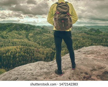Tourist with backpack hike on mountain trek. Trekking in mountains. Sharp exposed sandstone hills. Leisure activity. Sport tourism. Adventures of hikers