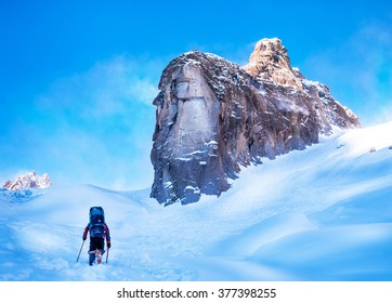 Tourist with a backpack and mountain panorama. Extreme sport concept