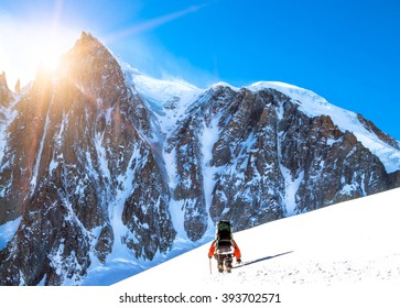 Tourist with a backpack and mountain panorama. Extreme sport con