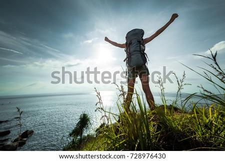 Tourist Backpack Standing On Sea Coast Stock Photo (Edit Now ... 505b6614d343b