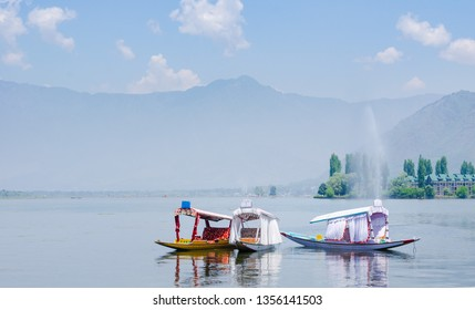 Tourist barges for romantic escapes on Srinagar Lake, a popular travel destination in Kashmir, India