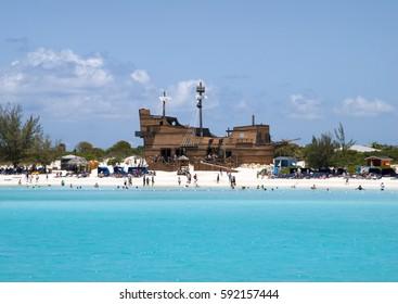 The tourist beach with a ship shape structure on uninhabited island Half Moon Cay.
