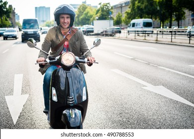Tourist in Berlin riding scooter in dense traffic