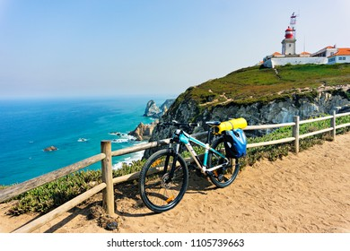 Tourist bike is parked on the westernmost point of the continent Europe. Portugal, Cape Roca.