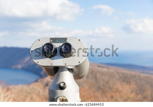 Tourist Binocular in landscape