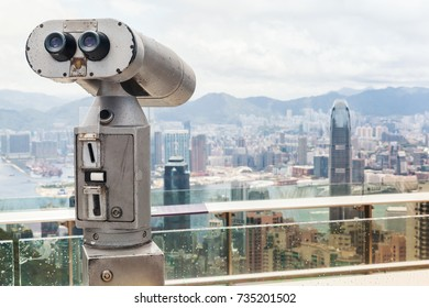 Tourist binocular telescope for Hong Kong city observation from Victoria Peak viewpoint