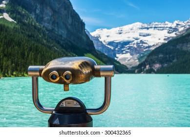 Tourist binoculars at Lake Louise in Alberta, Canada