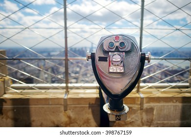 Tourist binoculars at the top of the Empire State Building in New York City