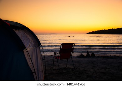 Tourist blue tent on sea beach. Holiday and summer vacation travel concept