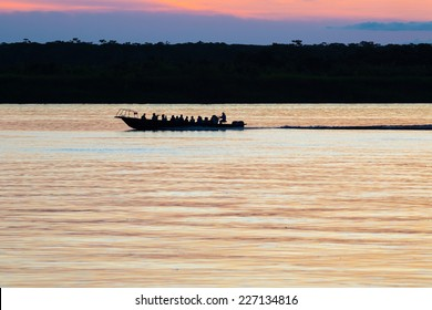 Tourist boat cross the Amazon river at the sunset. Iquitos, Peru