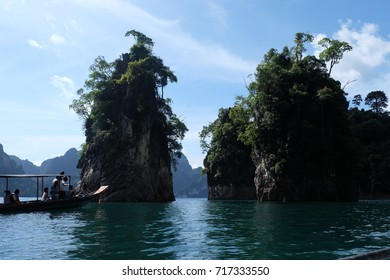 The tourist boat was floated in front of the giant rocks at Surat Thani, August 2017