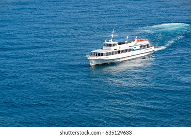 Tourist boat floats in the Black Sea, Crimea, Russia. Seascape with lone vessel. Water trip in Crimea. Beautiful view of the sea with a ship. Concept of the sea voyage for background with copy space.