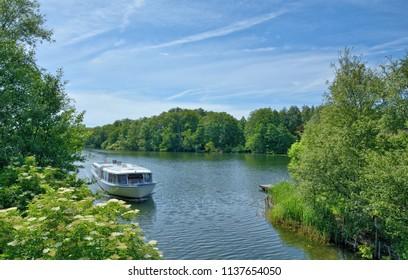 Tourist Boat at Lake Dieksee in Holstein Switzerland near Malente,Schleswig-Holstein,Germany