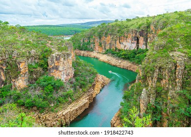 Tourist boat navigating between the Canyons of Furnas, Capitólio MG Brazil. Beautiful landscape of eco tourism of Minas Gerais state. Walls of sedimentary rocks and the green water of Lake of Furnas