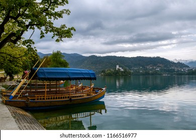 Tourist boat on the on Lake Ble. Church on the island at Bled lake. Slovenia, Europe.