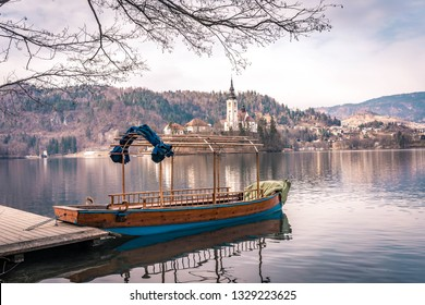 tourist boat on lake Bled with the church of the Ascension at the background